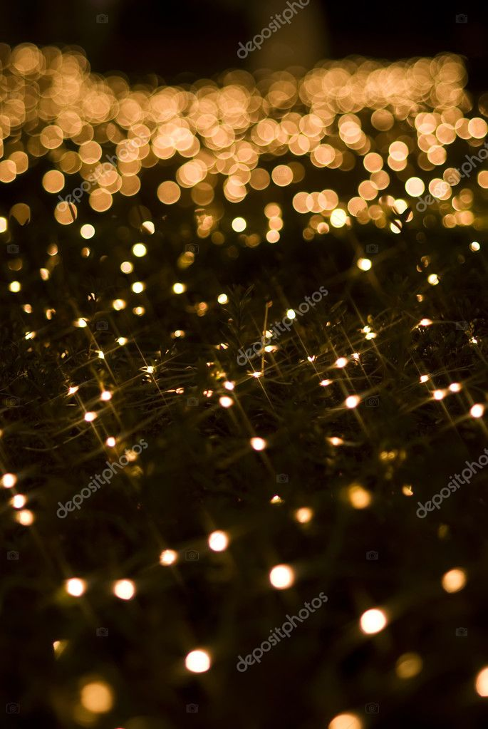Defocused yellow light effect against black background, — Stock Photo #2914188