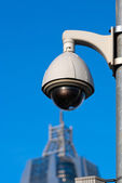 Surveillance Cameras of Office Building Under Blue Sky — Stock Photo
