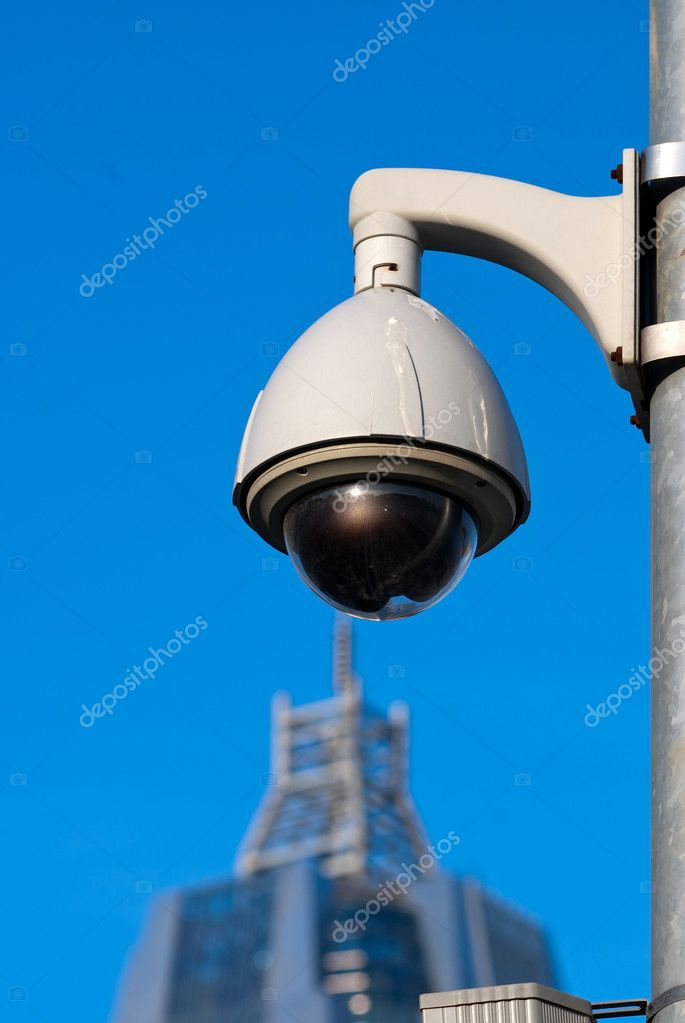 Surveillance Cameras of Office Building Under Blue Sky   Stock Photo #3829922