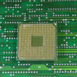 Central microprocessors for a computer on a circuit board background - Stock Photo