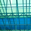 Contemporary office building blue glass wall detail — Stock Photo #3074574