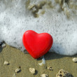 Red heart on reef seacoast — Stock Photo