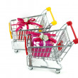 Christmas decoration box with shopping carts over white background — Stock Photo #3089184