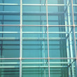 Contemporary office building blue glass wall detail — Stock Photo #3089240