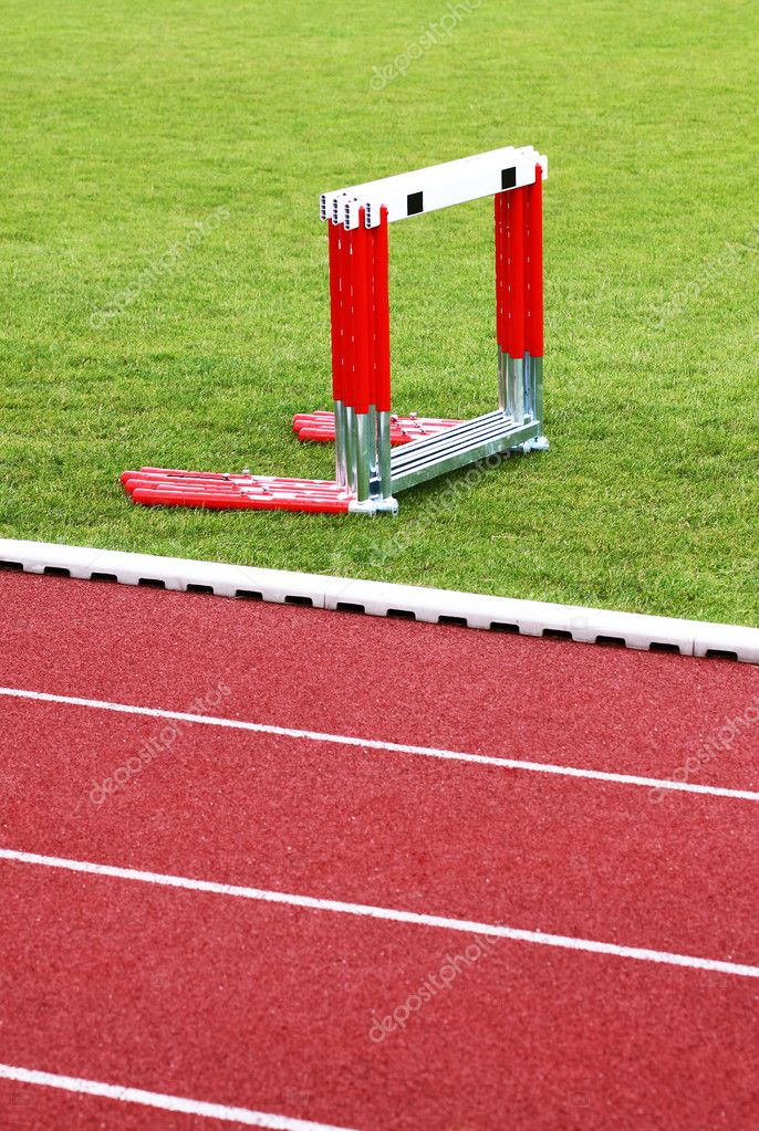 Track and hurdles on the green lawn — Stock Photo #2878296