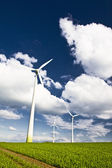 Windmills against a blue sky — Stock Photo