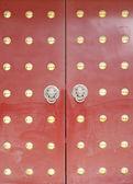 Grunge ancient red old door — Stock Photo