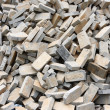 Pile of gray bricks at site of street repair - Stock Photo