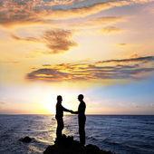 Couple on sunrise — Stock Photo