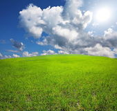 Field and clouds — Stock Photo