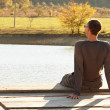 Man resting on  lake - Stock Photo