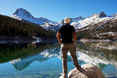 Man on lake — Stock Photo