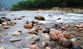 Water flowing over the mountain rocks — Stock Photo