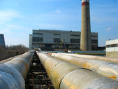 Pipes, tubes, machinery at power plant — Stock Photo