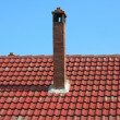 Stock Photo: Red brick chimney on tile roof