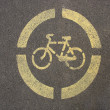 Stock Photo: Yellow sign of a bicycle on the asphalt