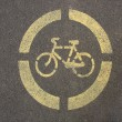 Yellow sign of a bicycle on the asphalt — Stock Photo