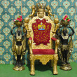 Stock Photo: Vintage luxury throne chair with two egyptian statues