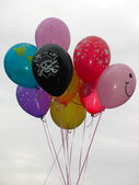 Group of colorful helium-filled balloons over sky — ストック写真