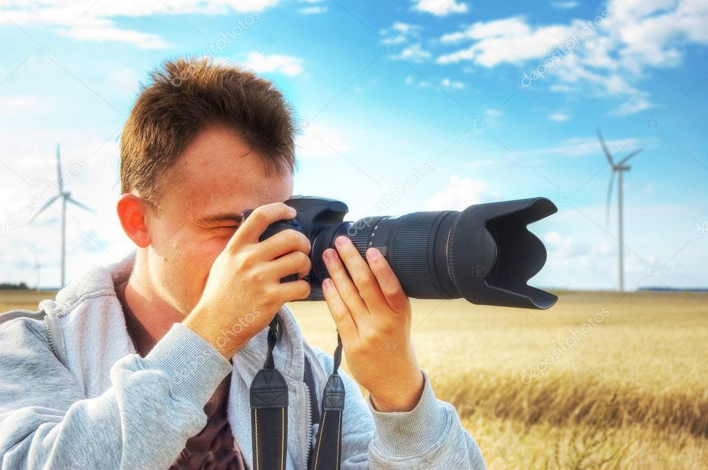 Professional photographer taking pictures. — Stock Photo #3889002