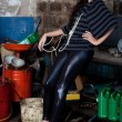 Fashion shot in auto repair shop. — Stock Photo