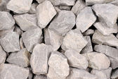 Gray crushed stone background — Stockfoto