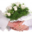 Stock Photo: Bride and groom hands with bouquet