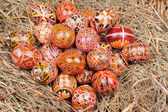Easter eggs on the hay — Stock Photo