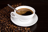 Hot coffee and coffee beans — Stock Photo
