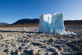 Iceberg in the middle of a dried out lake — Stock Photo