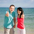 A couple on beach have fun — Stock Photo