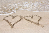 Hearts written on the sand — Stock Photo