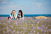 A couple on field of flowers — Stock Photo