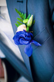 Boutonniere on the jacket of groom — Stock Photo