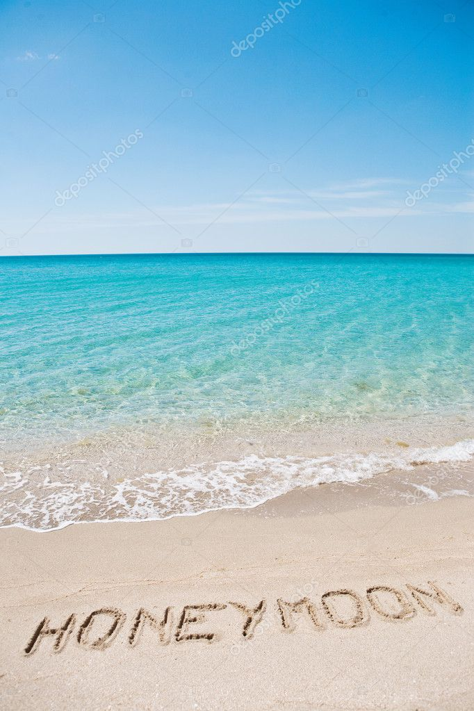 Honeymoon written on the sand  Stock Photo #3679780