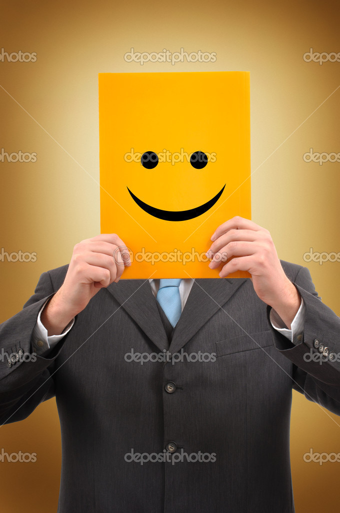 Businessman in gray suite is holding a yellow folder with happy face drawn on it  Stock Photo #2847134