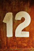 Number twelve written on an old, grunge iron gate — Stock Photo