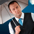 Stock Photo: Businessman with umbrella