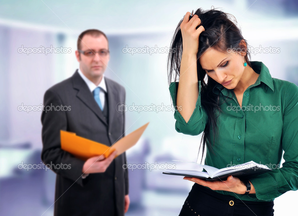 Business situation, manager  having doundts about young employees skills — Stock Photo #3903491