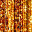 Amber beads. Background - Stock Photo
