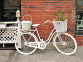 Detail design summer cafe with a bicycle, painted white — Stock Photo