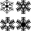 Stock Vector: Set of Snowflake Silhouettes
