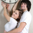 Boy and girl with hours — Stock Photo