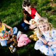Children with toys on grass — Stock Photo