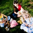 Children with toys on grass — Stock Photo #3177249