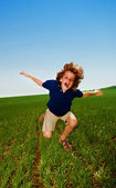 Cheerful boy in field — Stock Photo