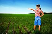 Small girl in field — Stock Photo