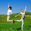 Boy and girl are jumping — Stock Photo