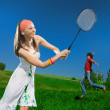 Girl with racket and boy — Stock Photo #3261310
