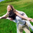 Long-haired girl with boy on grass — Stock Photo #3361720